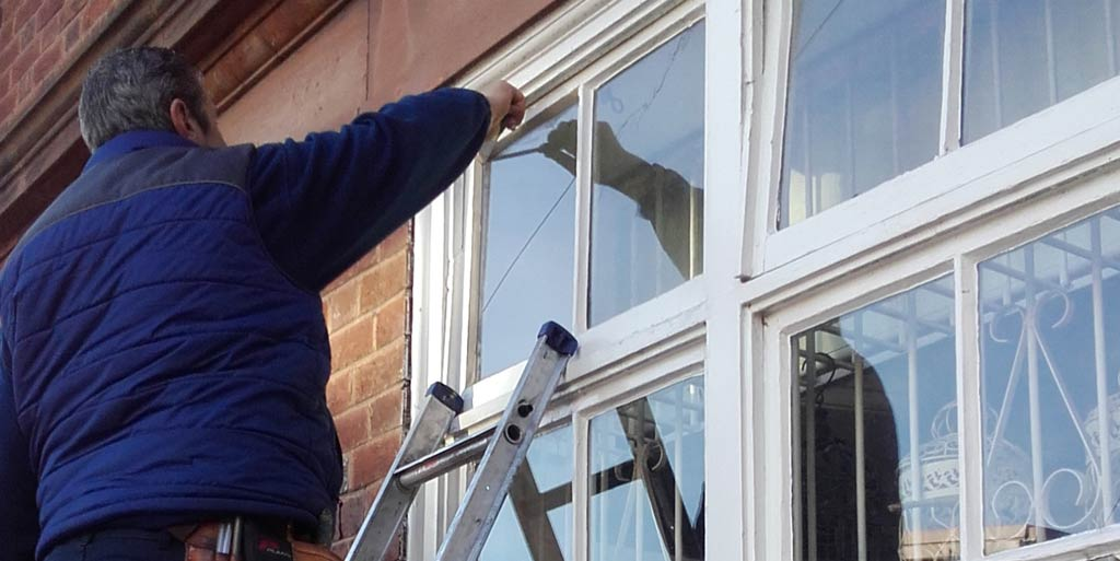 Jeff repairing a broken single pane glass unit on the Wirral