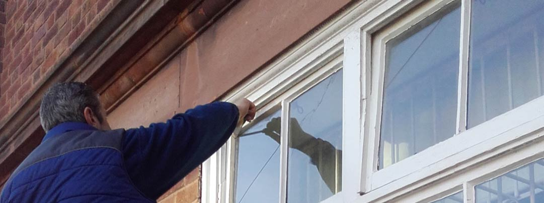 Jeff completeing a glazing repair in Thurstaston, Wirral to a period property.