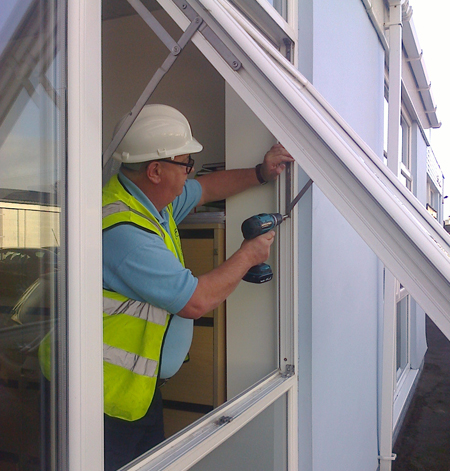 Steve fixing a broken hinge of a UPVC casement window Wirral.