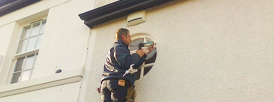 Our glazing specialist Jeff, Repairing a round (circular) window in Heswall, Wirral.