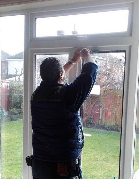 Jeff replacing a broken glass unit in a UPVC set of french doors in Chester.